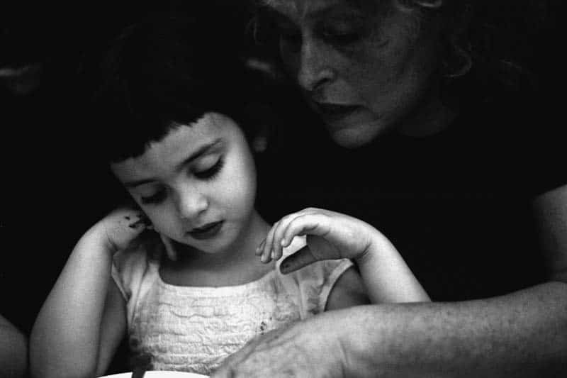 Black and white photo of a girl with her grandmother