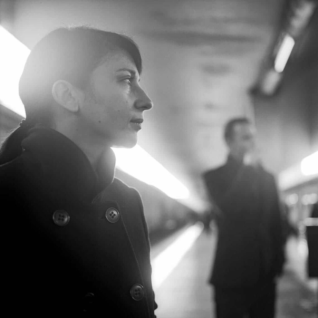 Black and white portrait of a woman on a station platform