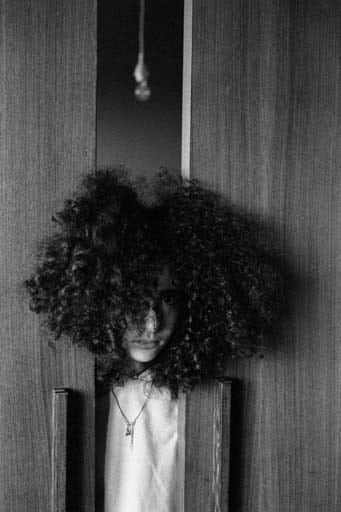 Black and white photo of a girl with curly hair