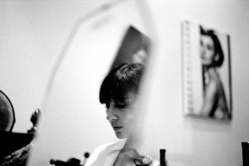 Black and white portrait of a woman in the mirror